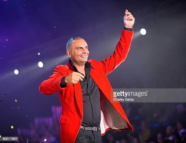 Designer Christian Audigier makes an appearance on the runway after an Ed Hardy presentation at the Macy's Passport 2008 Gala at Santa Monica...