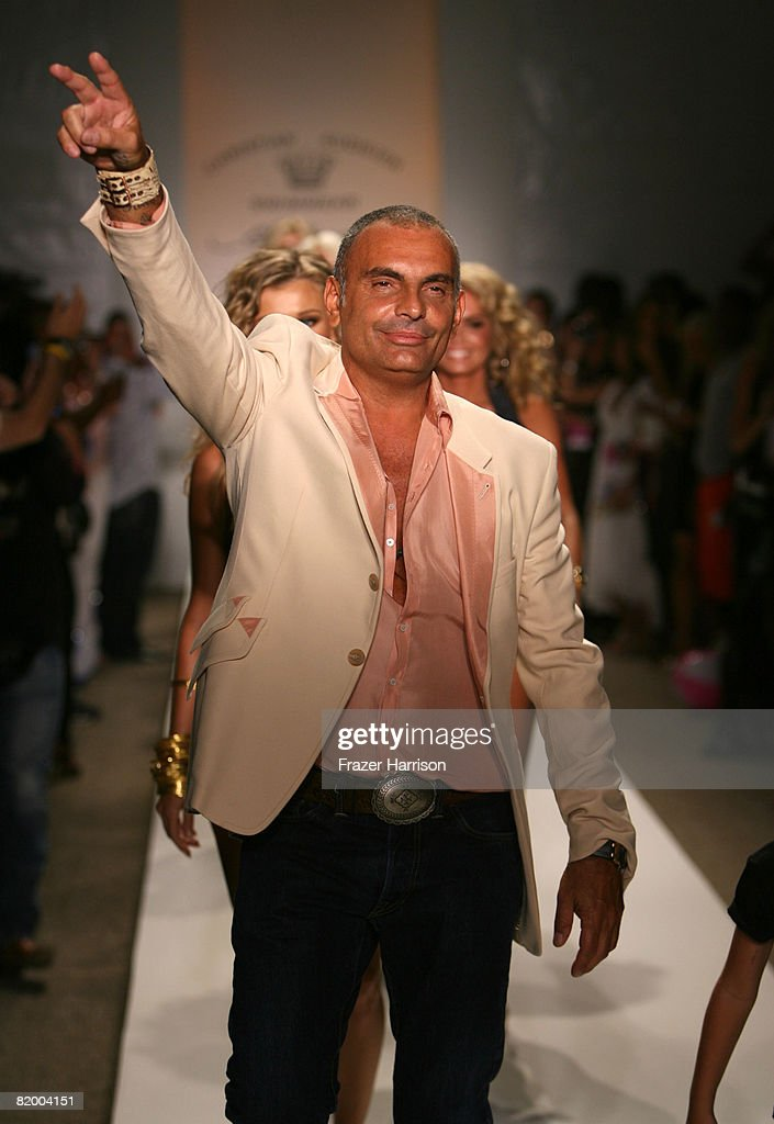 e200a6b6db Designer Christian Audigier walks the runway at Ed Hardy Swimwear ...