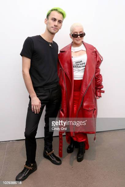 Designer Christian Cowan and Christina Aguilera pose backstage at the Christian Cowan Show during New York Fashion Week at Gallery II at Spring...
