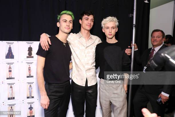 Designer Christian Cowan and Troye Sivan pose backstage at the Christian Cowan Show during New York Fashion Week at Gallery II at Spring Studios on...