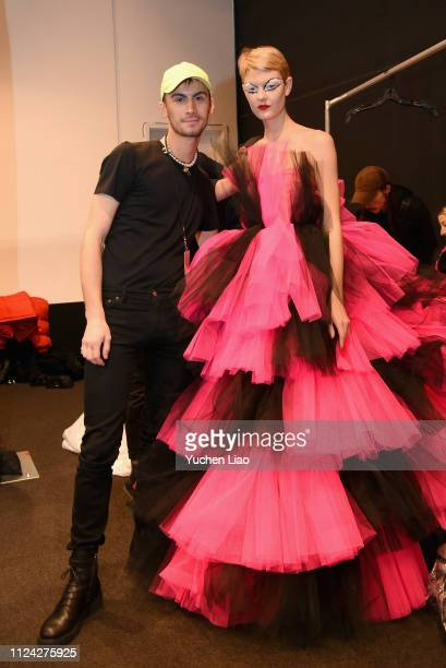 Designer Christian Cowan poses with a model backstage for Christian Cowan fashion show during New York Fashion Week The Shows at Gallery II at Spring...