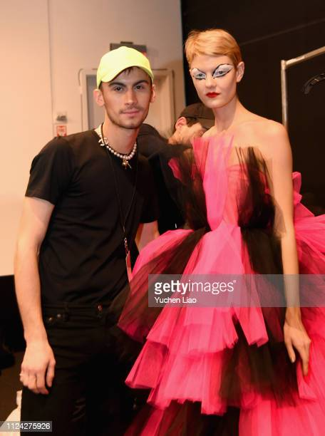 Designer Christian Cowan poses with a model backstage for Christian Cowan fashion show during New York Fashion Week: The Shows at Gallery II at...