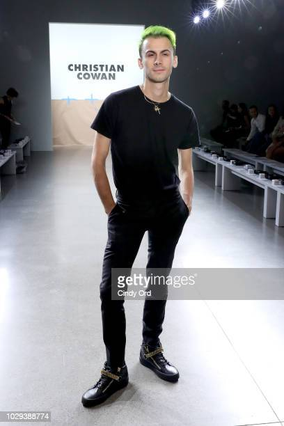 Designer Christian Cowan prepares backstage at the Christian Cowan Show during New York Fashion Week at Gallery II at Spring Studios on September 8...