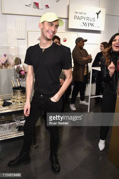 Designer Christian Cowan toasts his latest collection in The Café by Papyrus during New York Fashion Week: The Shows at Spring Studios on February...