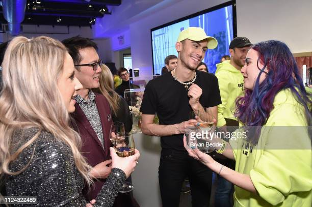 Designer Christian Cowan toasts his latest collection with CMO of Papyrus Alex Ho and guests in The Café by Papyrus during New York Fashion Week: The...