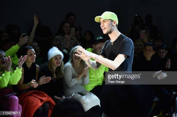 Designer Christian Cowan walks the runway at the Christian Cowan front row during New York Fashion Week: The Shows at Gallery II at Spring Studios on...