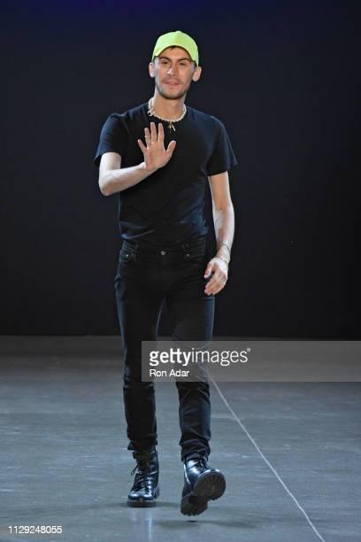 Designer Christian Cowan walks the runway at the Christian Cowan show during New York Fashion Week Fall Winter 2019 at Gallery II at Spring Studios...