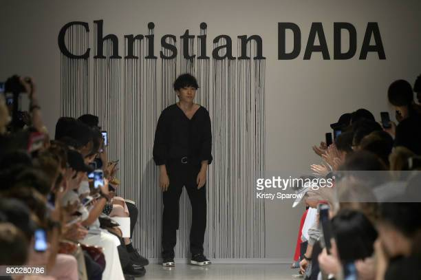 Designer Christian Dada acknowledges the audience during the Christian Dada Menswear Spring/Summer 2018 show as part of Paris Fashion Week on June 23...