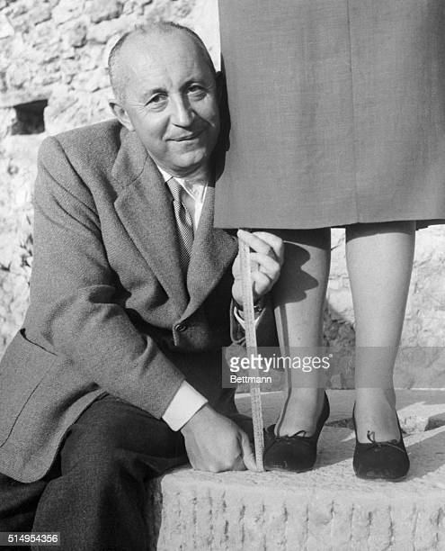Designer Christian Dior illustrates the new hemline 151/2 inches from the ground but adds that skirt lengths must necessarily be a question of the...