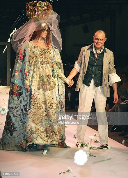 Designer Christian Lacroix and model walking the runway during Paris Haute Couture Fashion Week for Fall/Winter 2007 2008 in Paris France on July3...