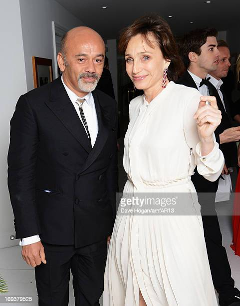 Designer Christian Louboutin and actress Kristin Scott Thomas attend the after party for amfAR's 20th Annual Cinema Against AIDS during The 66th...