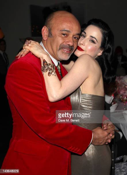 Designer Christian Louboutin and Dita Von Teese attend a private dinner hosted by Liberty celebrating the Dita Von Teese perfume launch at The Arts...