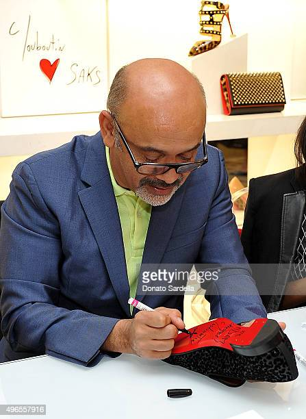 Designer Christian Louboutin is pictures at his personal appearance and shoe signing at Saks Fifth Avenue Beverly Hills on November 10 2015 in...