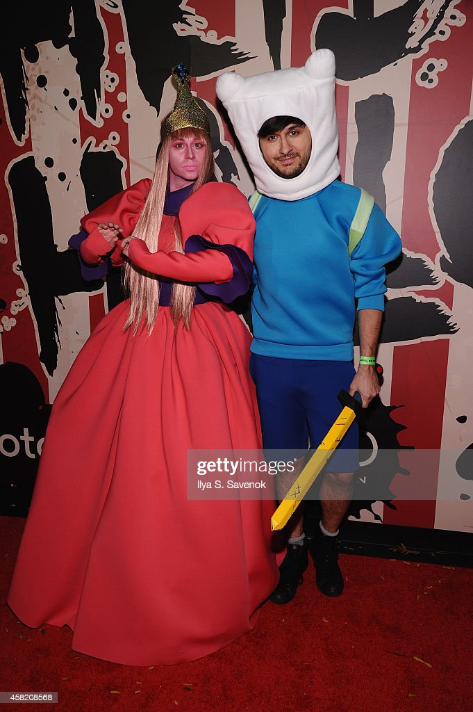 Designer Christian Siriano and Brad Walsh attends Moto X presents Heidi Klum's 15th Annual Halloween Party sponsored by SVEDKA Vodka at TAO Downtown on October 31, 2014 in New York City.