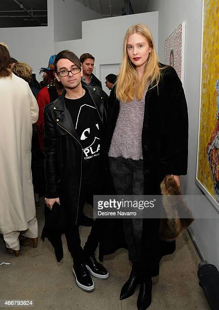 Designer Christian Siriano and model Jasmine Poulton attend Tali Lennox Exhibition Opening Reception at Catherine Ahnell Gallery on March 18 2015 in...