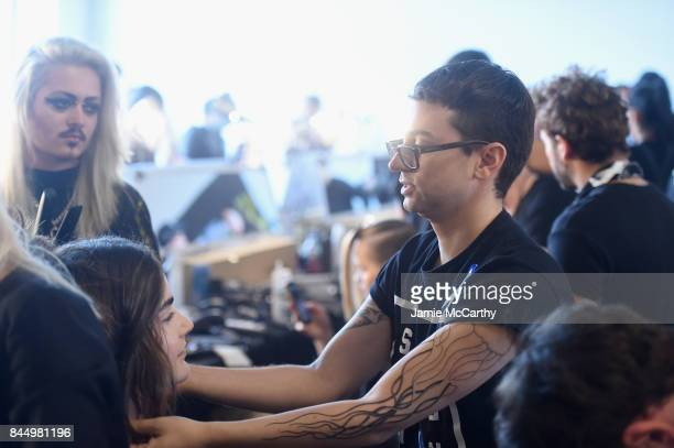 Designer Christian Siriano prepares a model backstage for the Christian Siriano fashion show during New York Fashion Week The Shows at Pier 59 on...