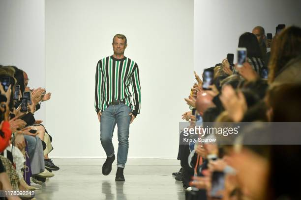 Designer Christian Wijnants acknowledges the audience during the Christian Wijnants Womenswear Spring/Summer 2020 show as part of Paris Fashion Week...