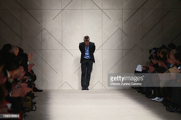 Designer Christopher Bailey acknowledges the applause of the audience after the Burberry Prorsum show as part of Milan Fashion Week Menswear...