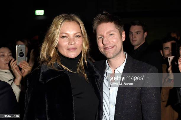 Designer Christopher Bailey and model Kate Moss wearing Burberry at the Burberry February 2018 show during London Fashion Week at Dimco Buildings on...