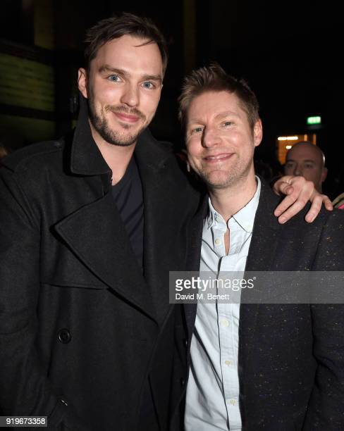 Designer Christopher Bailey and Nicholas Hoult are seen following the Burberry February 2018 show during London Fashion Week at Dimco Buildings on...