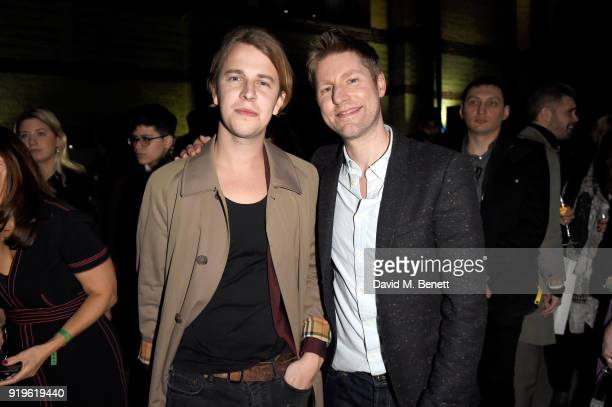 Designer Christopher Bailey and Tom Odell seen at the Burberry February 2018 show during London Fashion Week at Dimco Buildings on February 17 2018...