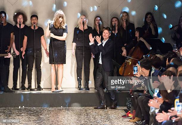 Designer Christopher Bailey appears at the end of the runway after the Burberry Prorsum show at the London Collections: Men AW15 at Albert Memorial...