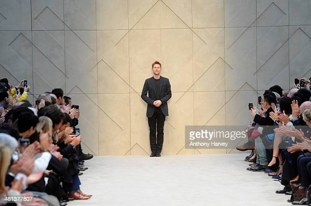 Designer Christopher Bailey appears at the end of the runway at the Burberry AW14 Menswear Show at Kensington Gardens on January 8, 2014 in London,...
