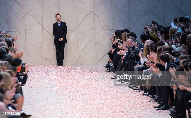 Designer Christopher Bailey appears on the runway after the Burberry Prorsum show at London Fashion Week SS14 at Kensington Gardens on September 16,...