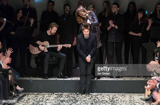 Designer Christopher Bailey appears on the runway after the runway after the Burberry Prorsum show during London Fashion Week Fall/Winter 2015/16 at...