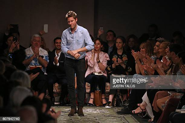 Designer Christopher Bailey Chief Creative and Chief Executive Officer for Burberry acknowledges the audience after the 2017 Spring / Summer catwalk...