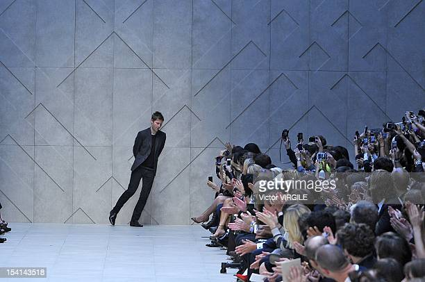 Designer Christopher Bailey walks on the catwalk by Burberry Prorsum on day 4 of London Fashion Week Spring/Summer 2013, at Kensington Gardens on...