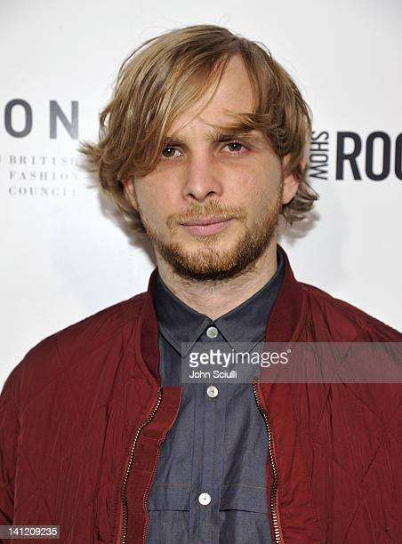 Designer Christopher De Vos attends the British Fashion Council's LONDON Show ROOMS LA opening cocktail party at Smashbox Studios on March 12 2012 in...