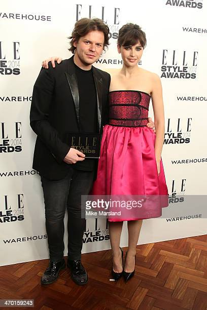 Designer Christopher Kane winner of the British Designer of the Year poses with actress Felicity Jones in the winners room at the Elle Style Awards...