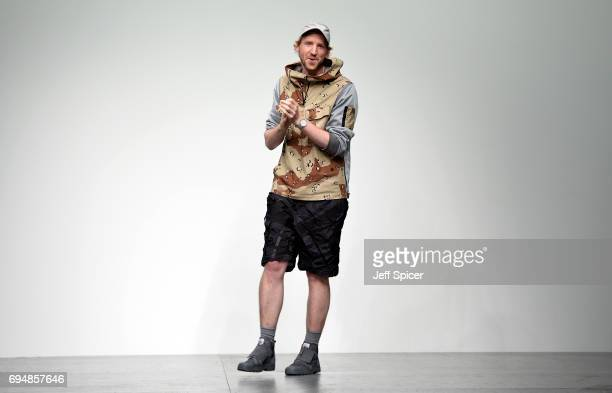 Designer Christopher Raeburn appears at the end of the catwalk following the Christopher Raeburn show during the London Fashion Week Men's June 2017...