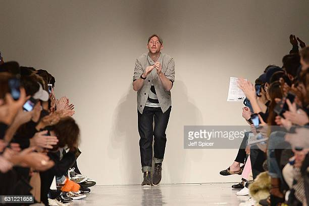 Designer Christopher Raeburn is seen on the runway at the Christopher Raeburn show during London Fashion Week Men's January 2017 collections at BFC...