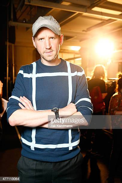 Designer Christopher Raeburn poses backstage at the Christopher Raeburn show during The London Collections Men SS16 at The Old Sorting Office on June...