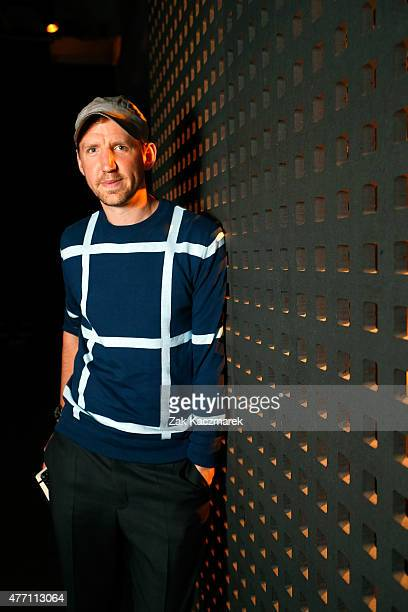 Designer Christopher Raeburn poses backstage at the Christopher Raeburn show during The London Collections Men SS16 at The Old Sorting Office on June...