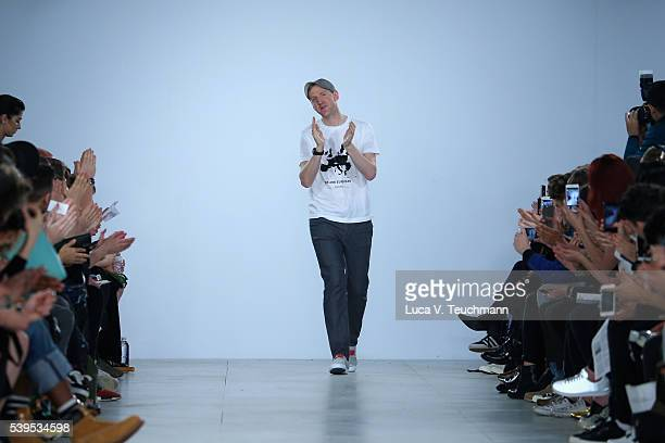 Designer Christopher Raeburn walks the runway after his show during The London Collections Men SS17 at BFC Show Space on June 12, 2016 in London,...