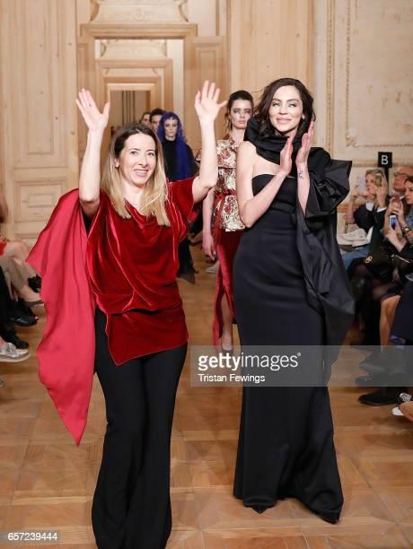 Designer Cigdem Akin and model Gunay Musayeva walks the runway at the Cigdem Akin show during MercedesBenz Istanbul Fashion Week March 2017 at Grand...