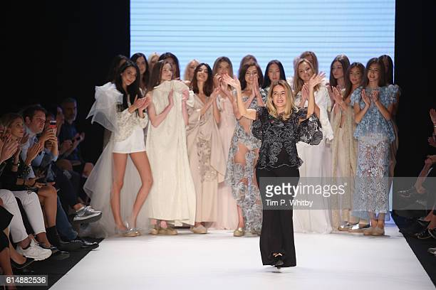 Designer Cigdem Akin walks the runway at the Cigdem Akin show during MercedesBenz Fashion Week Istanbul at Zorlu Center on October 15 2016 in...