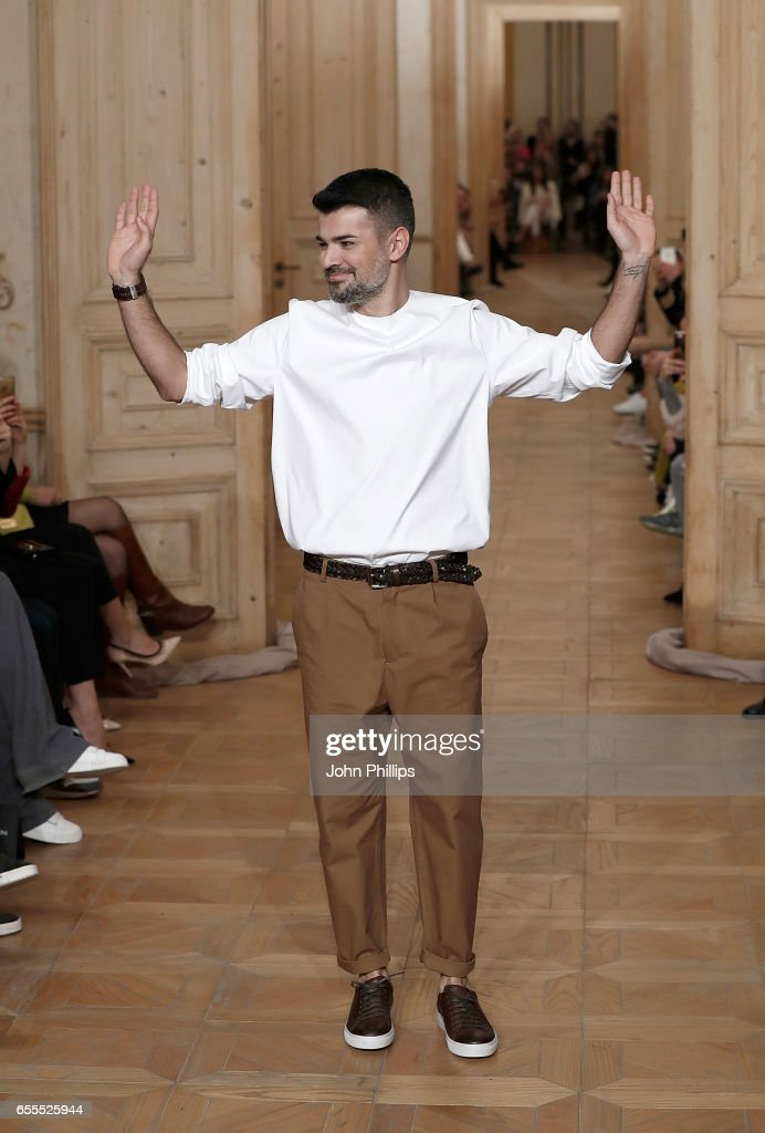 Designer Cihan Nacar appears on the runway after the Cihan Nacar show during Mercedes-Benz Istanbul Fashion Week March 2017 at Grand Pera on March 20, 2017 in Istanbul, Turkey.
