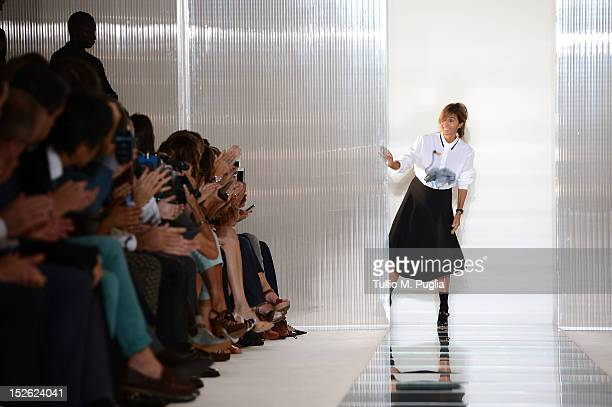 Designer Consuelo Castiglioni acknowledges the applause of the audience after the Marni Spring/Summer 2013 fashion show as part of Milan Womenswear...