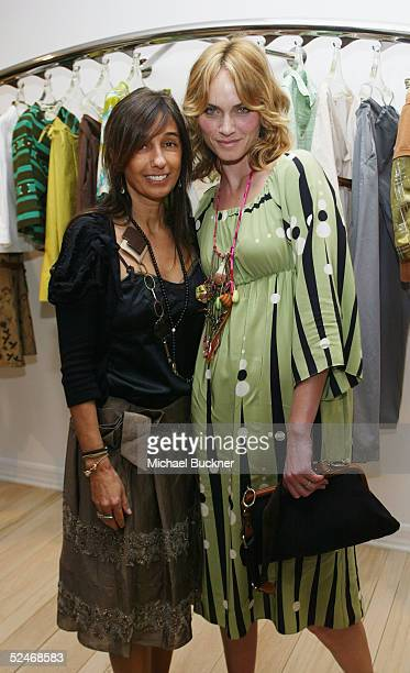 Designer Consuelo Castiglioni and actress Amber Valletta pose at the grand opening of Marni's Los Angeles Boutique on March 22, 2005 in Los Angeles,...