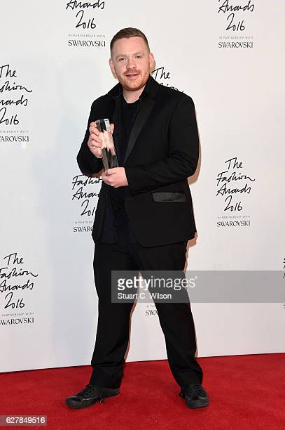 Designer Craig Green poses in the winners room after winning the award for British Menswear Designer at The Fashion Awards 2016 at Royal Albert Hall...