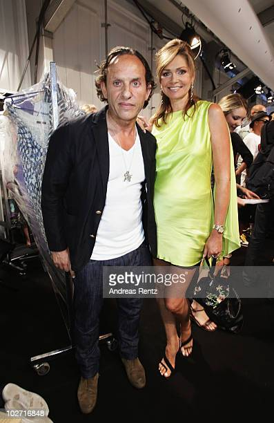 Designer Custo Dalmau and Maren Gilzer pose backstage at the Custo Barcelona Show during the Mercedes Benz Fashion Week Spring/Summer 2011 at...