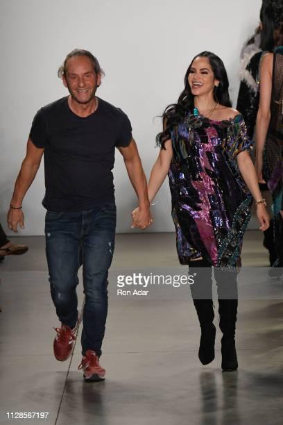 Designer Custo Dalmau and Singer Natti Natasha walk the runway at the Custo Barcelona Show during New York Fashion Week The Shows Fall Winter 2019 at...