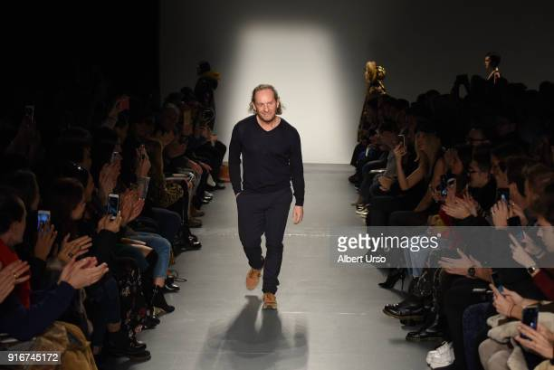 Designer Custo Dalmau walks the runway at the Custo Barcelona show during New York Fashion Week The Shows at Pier 59 on February 10 2018 in New York...