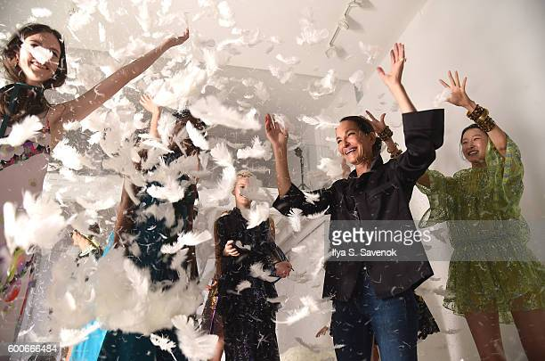 Designer Cynthia Rowley plays with feathers and models at Cynthia Rowley Presentation during New York Fashion Week The Shows on September 8 2016 in...