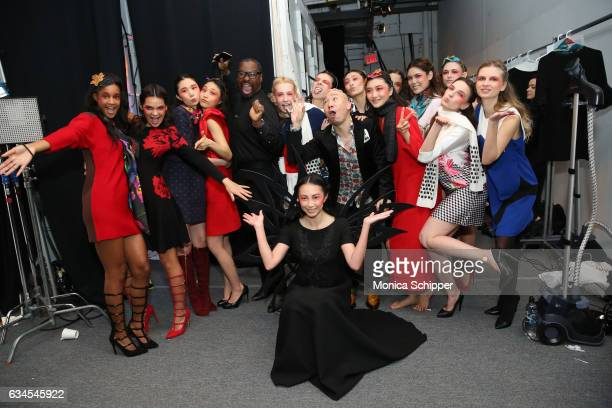 Designer Dan Liu poses with models backstage before the Dan Liu Collection during New York Fashion Week The Shows at Gallery 3 Skylight Clarkson Sq...