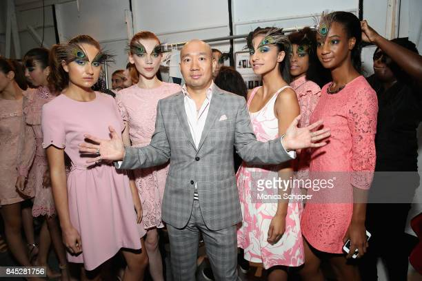 Designer Dan Liu poses with models backstage during Dan Liu fashion show during New York Fashion Week The Shows at Gallery 3 Skylight Clarkson Sq on...